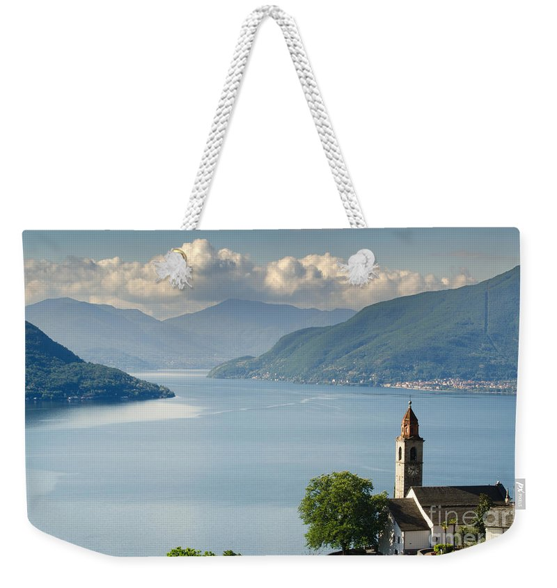 Church Weekender Tote Bag featuring the photograph Church Close To An Alpine Lake by Mats Silvan