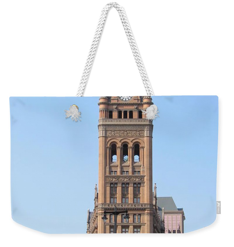 Milwaukee Weekender Tote Bag featuring the photograph City Hall And Trolley by Anita Burgermeister