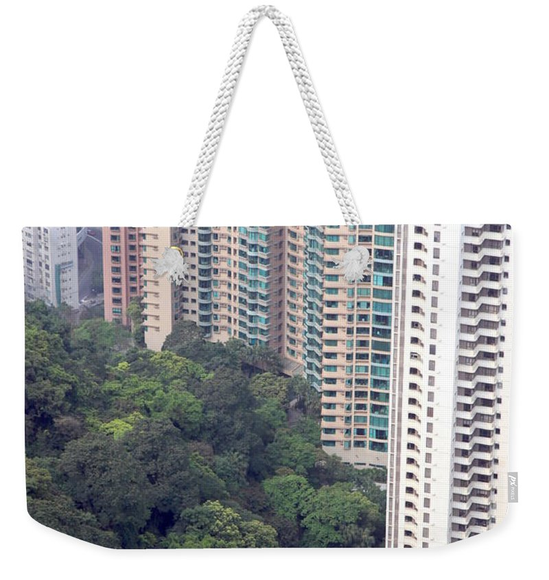 City Weekender Tote Bag featuring the photograph City Versus Nature by Valentino Visentini