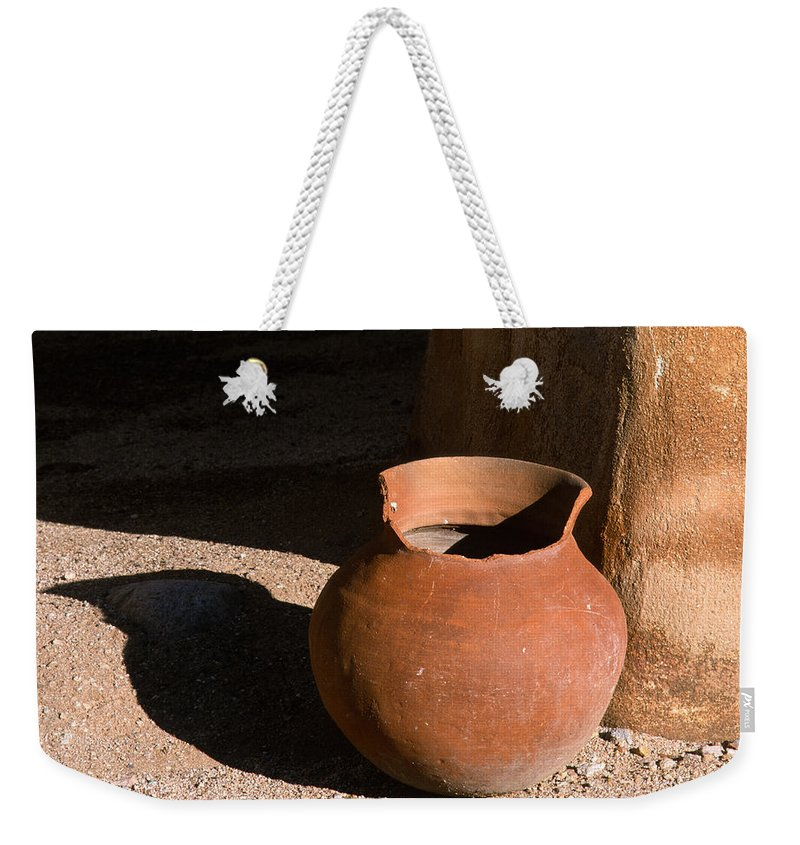 Mexican Pottery Weekender Tote Bag featuring the photograph Clay Pot And Shadow by Sandra Bronstein