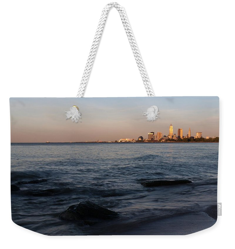 Cleveland Weekender Tote Bag featuring the photograph Cleveland From The Shadows by Dale Kincaid