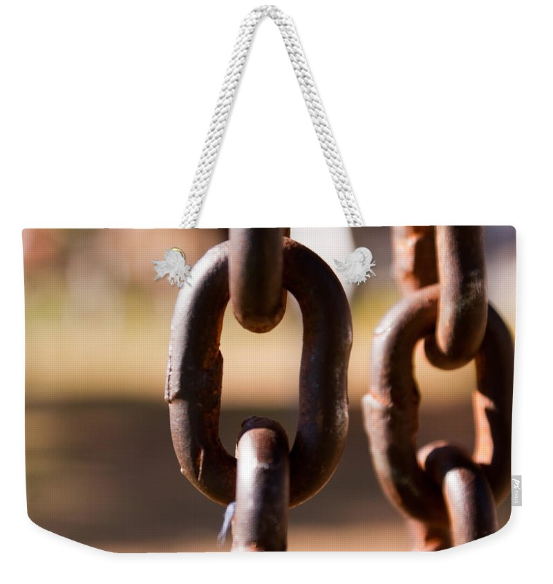 Metal Weekender Tote Bag featuring the photograph Close Up Of A Chain Link by Ashish Agarwal