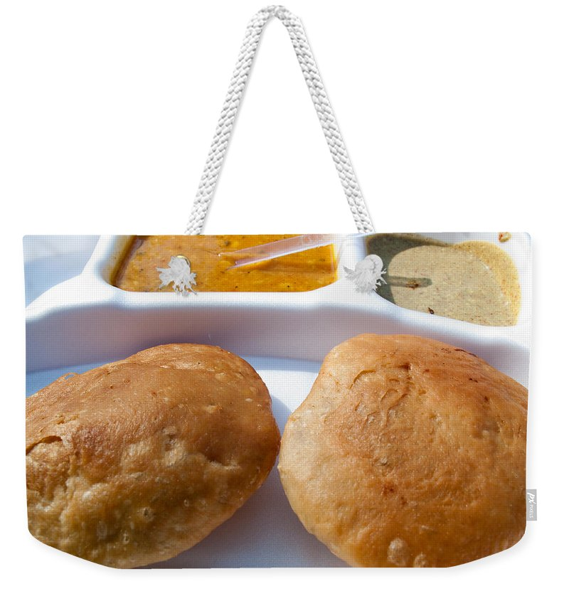 Kachori Weekender Tote Bag featuring the photograph Close Up Of A Plate Of Indian Food Delicacy Kachori With Sabzi And Chutney by Ashish Agarwal