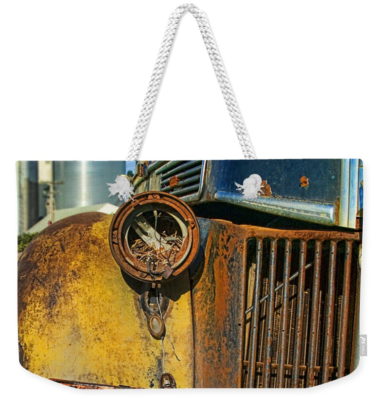Truck Weekender Tote Bag featuring the photograph Close Up Of Rusty Truck by Jill Battaglia