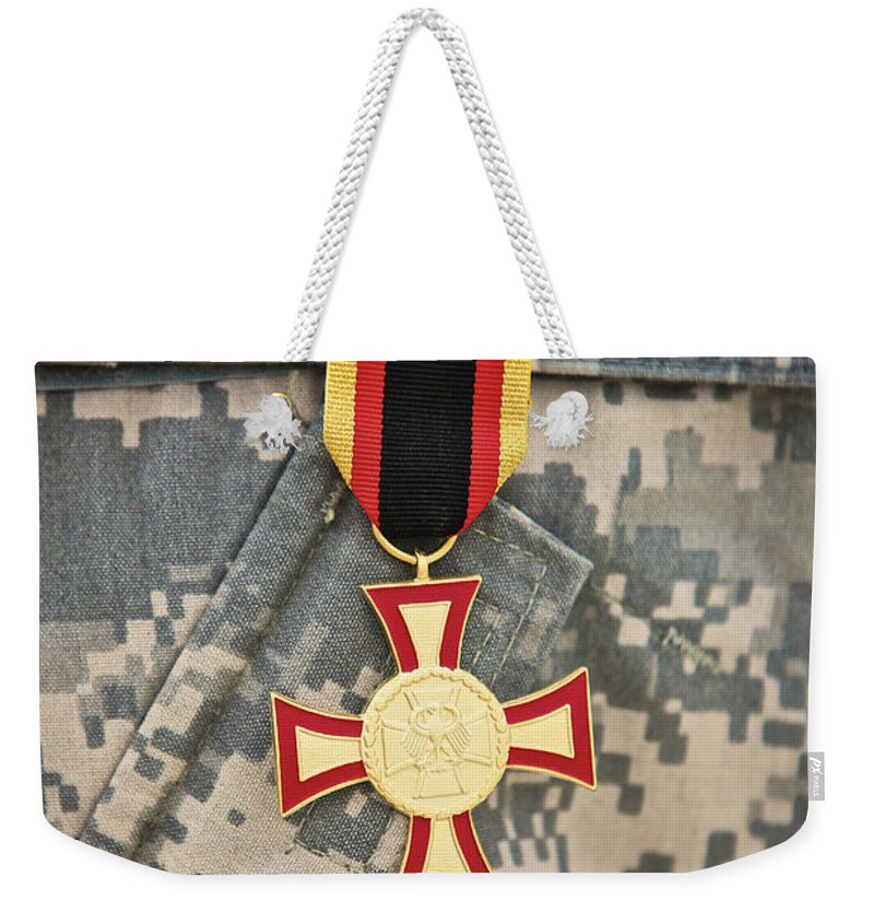Operation Enduring Freedom Weekender Tote Bag featuring the photograph Close-up View Of A German Gold Cross by Terry Moore