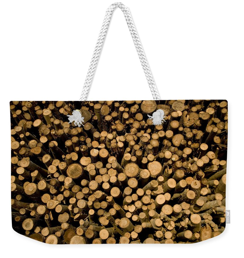 Tigre Weekender Tote Bag featuring the photograph Close View Of Freshcut Wood Waiting by Stephen St. John