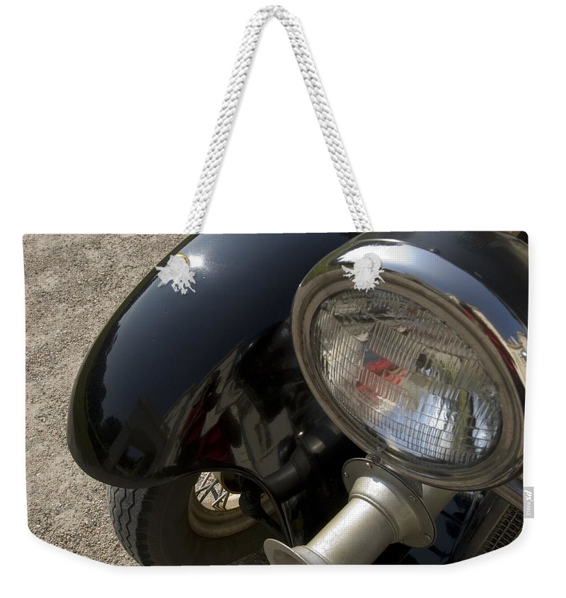 Old Weekender Tote Bag featuring the photograph Close View Of The Headlight by Todd Gipstein