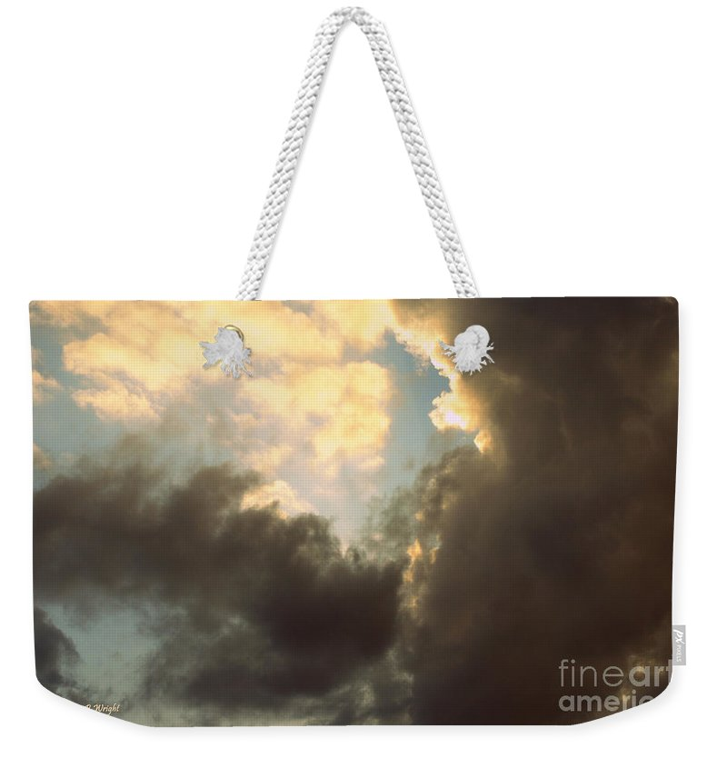 Drama Queen Weekender Tote Bag featuring the photograph Clouds-4 by Paulette B Wright