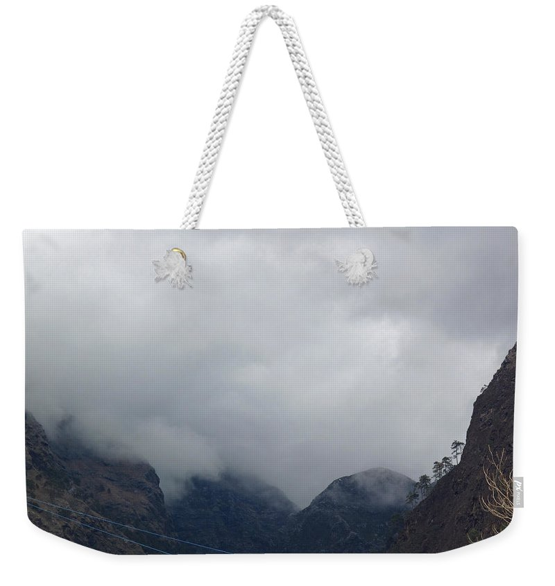 Jammu Weekender Tote Bag featuring the photograph Clouds Covering The Tops Of Various Mountain Peaks by Ashish Agarwal