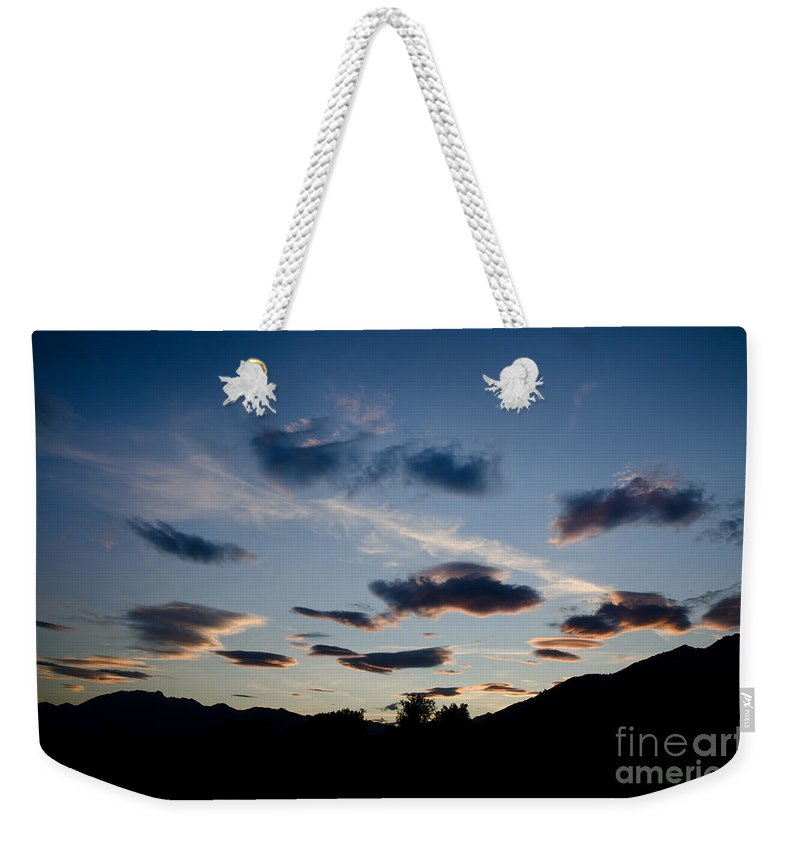 Clouds Weekender Tote Bag featuring the photograph Clouds by Mats Silvan