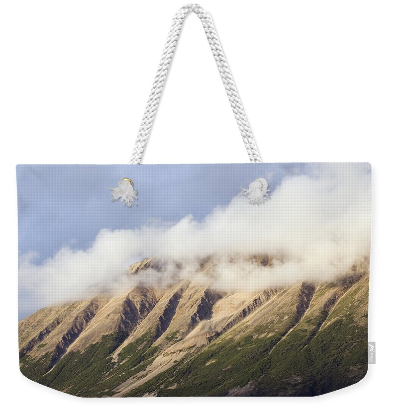 Clouds Weekender Tote Bag featuring the photograph Clouds Over Porphyry Mountain by Rich Reid