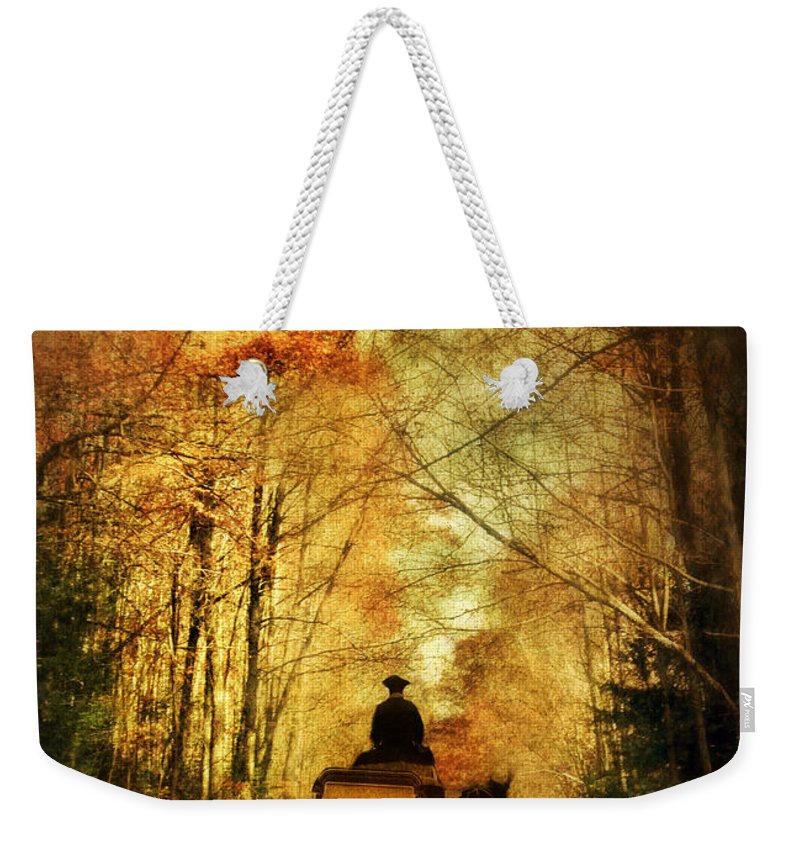 Carriage Weekender Tote Bag featuring the photograph Coach On A Road In Autumn by Jill Battaglia