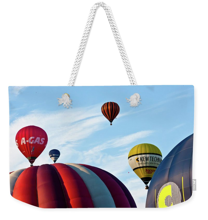 Balloons Weekender Tote Bag featuring the photograph Coming Through by Brian Roscorla