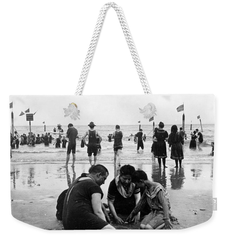 coney Island Weekender Tote Bag featuring the photograph Coney Island Beach Goers - C 1906 by International Images