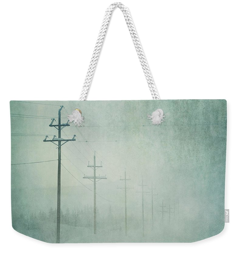 Bleak Weekender Tote Bag featuring the photograph Connenction by Priska Wettstein
