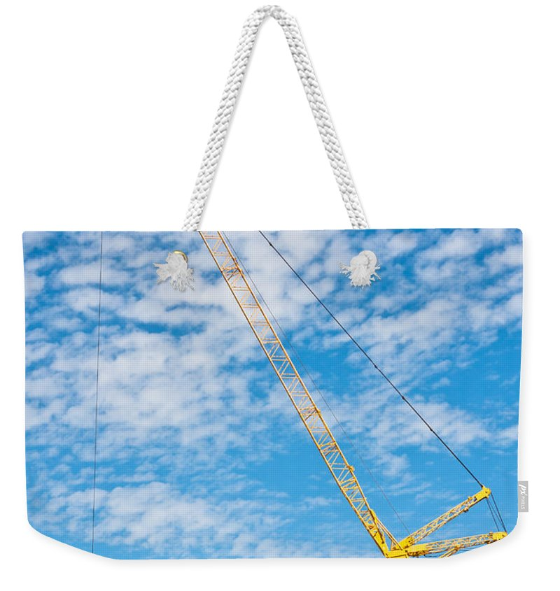 Activity Weekender Tote Bag featuring the photograph Construction Crane by Tom Gowanlock