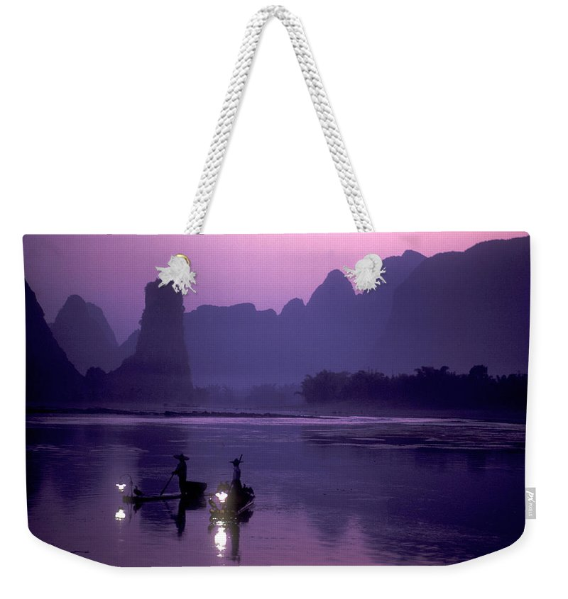 China Weekender Tote Bag featuring the photograph Cormorant Fishers Work At Dusk by Kenneth Ginn