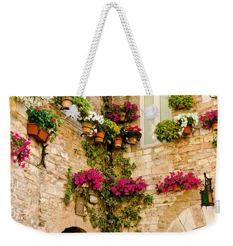 Colorful Flowers Weekender Tote Bag featuring the photograph Corner Of Flowers by Jon Berghoff