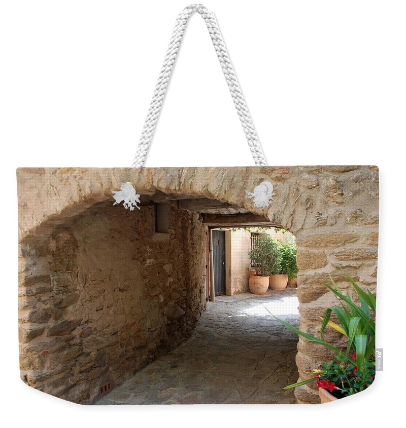 Courtyard Weekender Tote Bag featuring the photograph Courtyard In The Village by Dany Lison