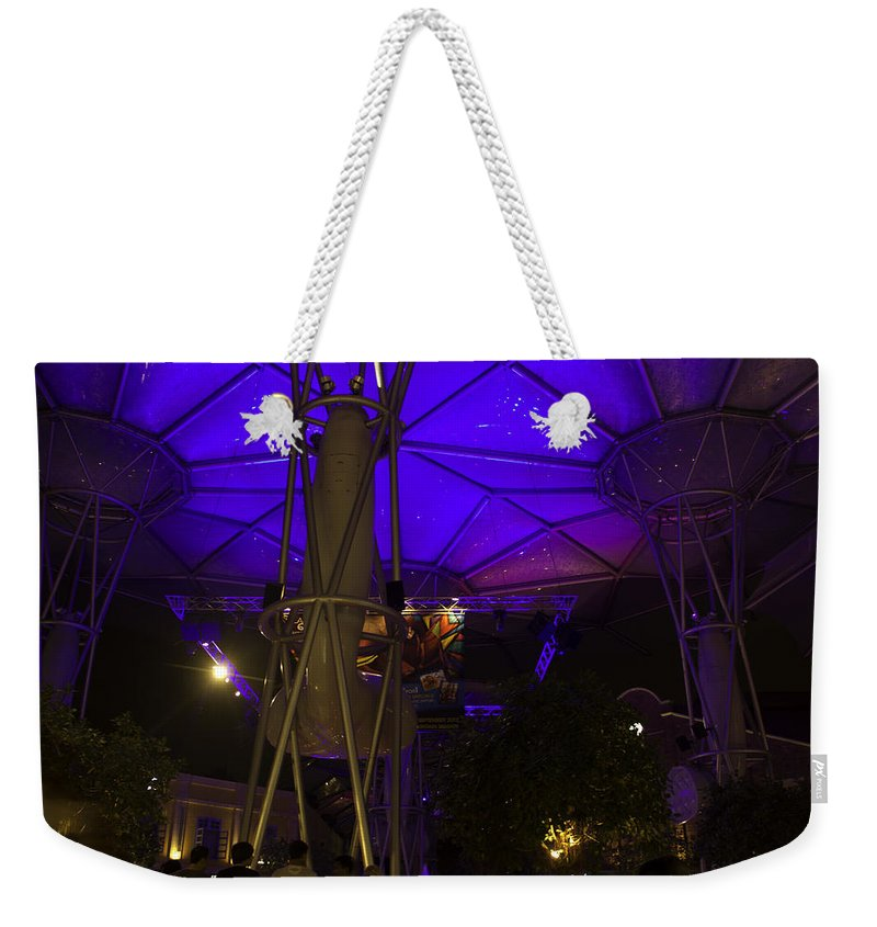 Action Weekender Tote Bag featuring the photograph Covered Stretch Of Clarke Quay With Restaurants And Other Attrac by Ashish Agarwal