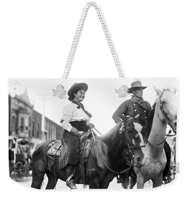 1908 Weekender Tote Bag featuring the photograph Cowboy And Cowgirl, C1908 by Granger