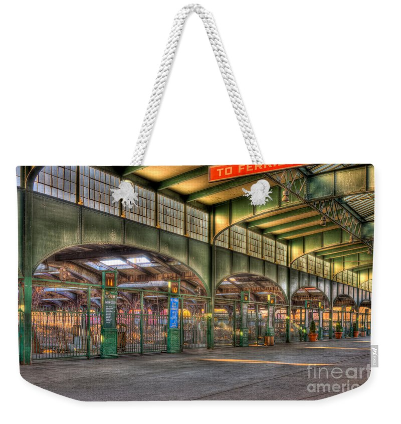 Clarence Holmes Weekender Tote Bag featuring the photograph Crrnj Terminal IIi by Clarence Holmes