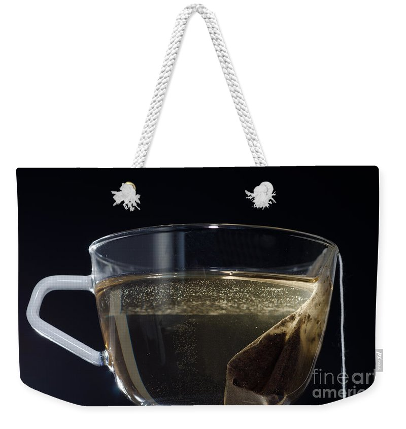 Tea Weekender Tote Bag featuring the photograph Cup Of Tea by Mats Silvan