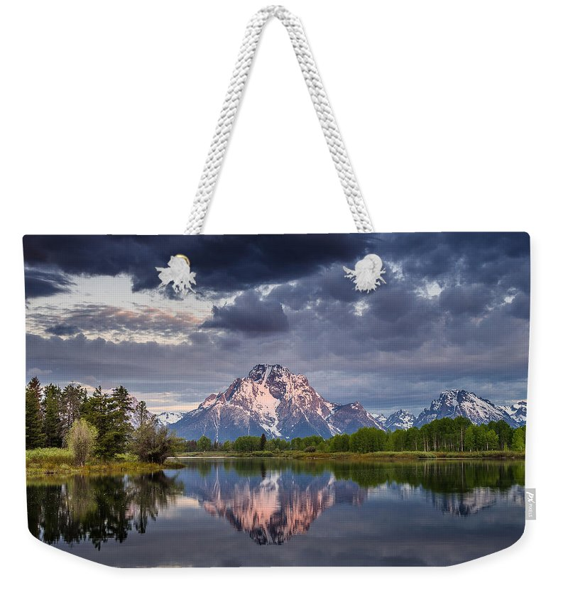 Grand Tetons National Park Weekender Tote Bag featuring the photograph Darkening Skies Over Oxbow Bend by Greg Nyquist
