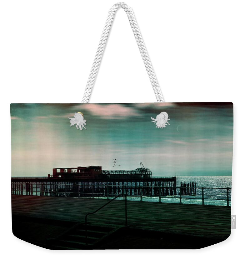 Seafront Weekender Tote Bag featuring the photograph Dawn On The Seafront At Hastings by Chris Lord