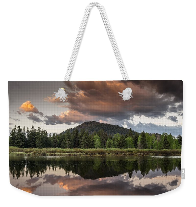 Grand Tetons National Park Weekender Tote Bag featuring the photograph Dawn On The Snake River by Greg Nyquist