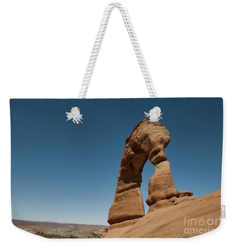 National Parks Weekender Tote Bag featuring the photograph Delicate Arch by David Arment