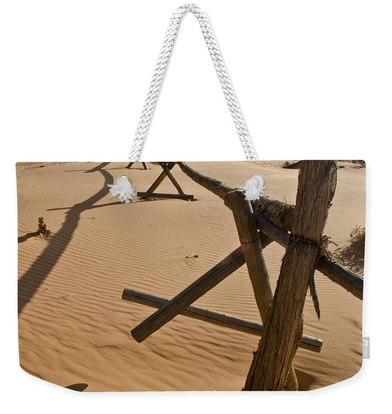 Coral Pink Sand Dunes Weekender Tote Bag featuring the photograph Desolate by Heather Applegate