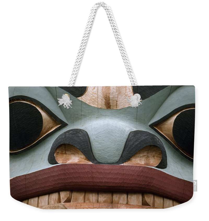 Religion Weekender Tote Bag featuring the photograph Detail Of A Totem Pole by Anne Keiser