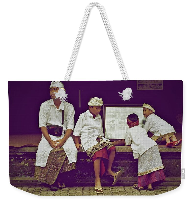 Photojournalism Weekender Tote Bag featuring the photograph Dressed And Ready by Valerie Rosen