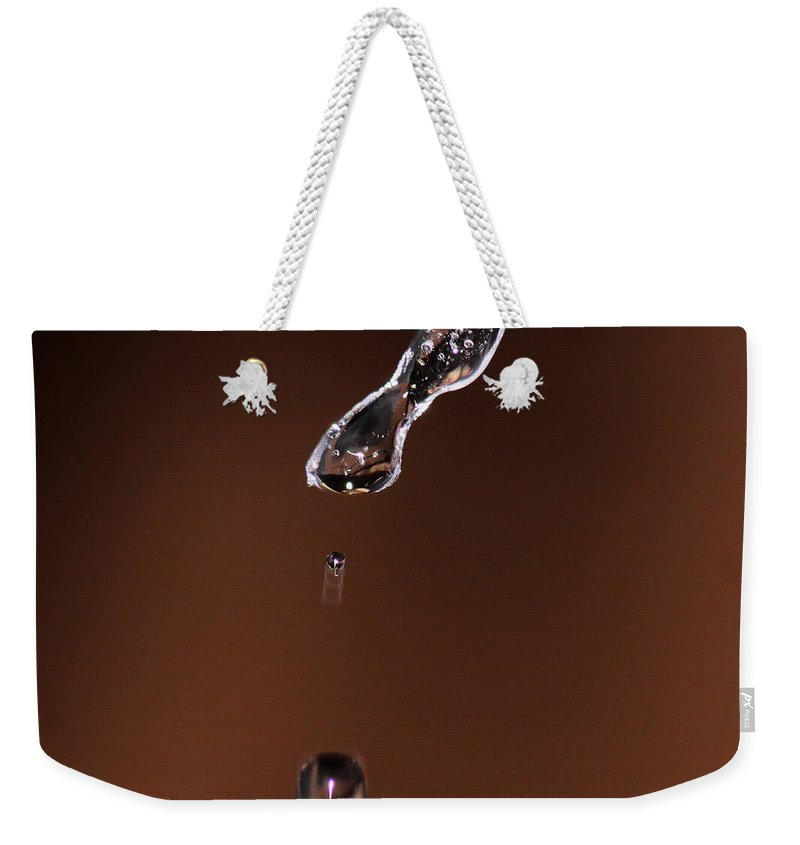 Water Weekender Tote Bag featuring the photograph Drop From And Icicle by Travis Truelove