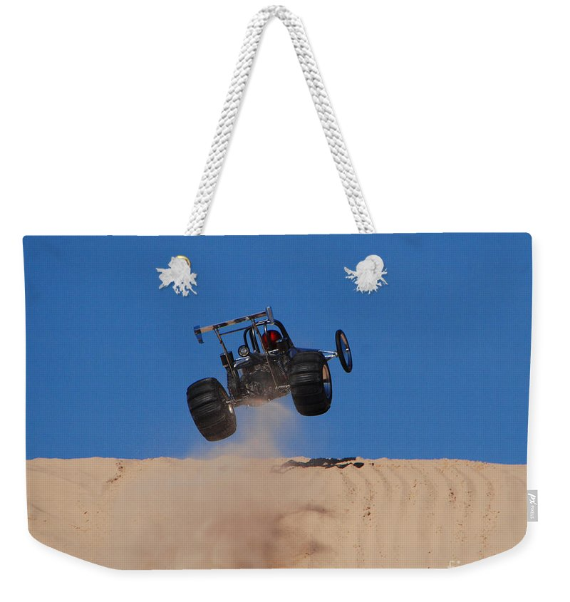 Dune Buggy Weekender Tote Bag featuring the photograph Dune Buggy Jump by Grace Grogan