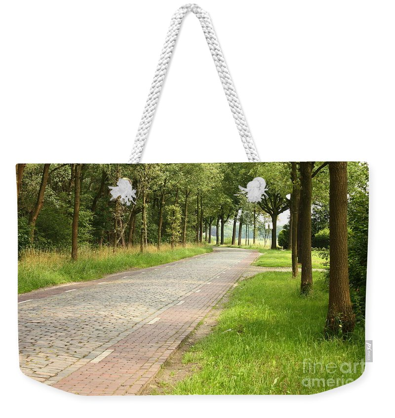 Cobblestone Road Weekender Tote Bag featuring the photograph Dutch Road 2 by Carol Groenen