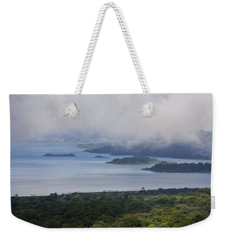 Arenal Weekender Tote Bag featuring the photograph Early Morning Fog Rises Over Lake by Hannele Lahti
