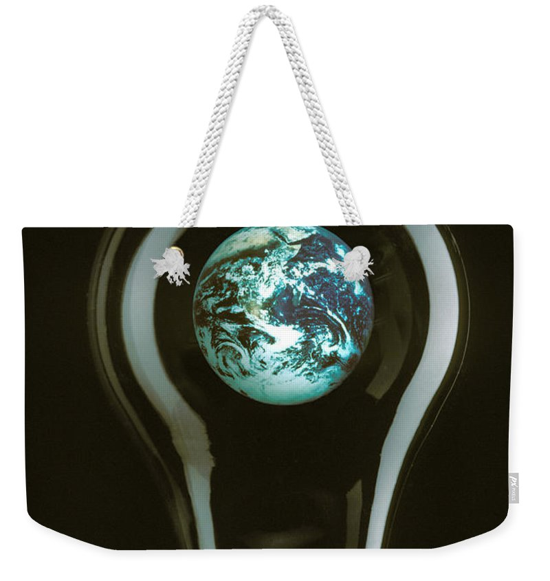Earth Weekender Tote Bag featuring the photograph Earth In Light Bulb by Garry Gay