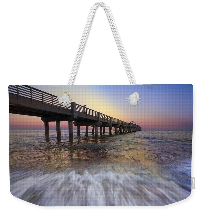 Clouds Weekender Tote Bag featuring the photograph Eastern Glow by Debra and Dave Vanderlaan