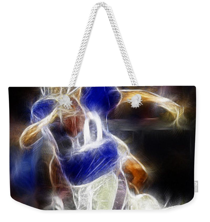 Eli Manning Weekender Tote Bag featuring the digital art Eli Manning Quarterback by Paul Ward