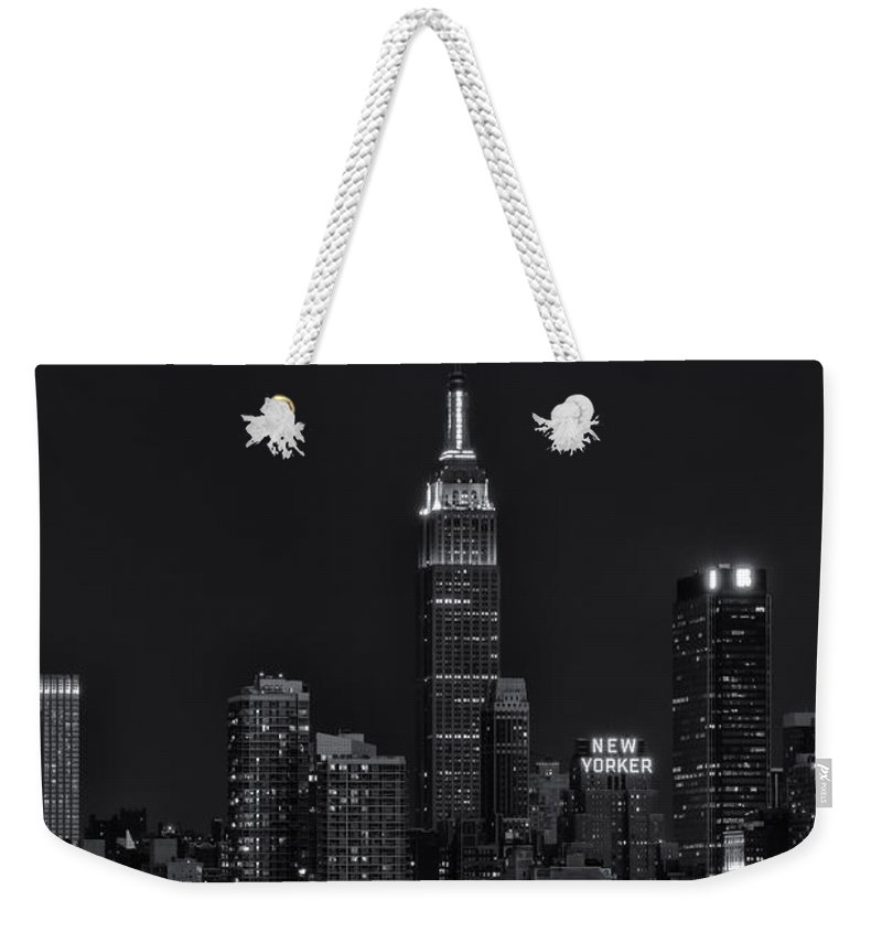 Clarence Holmes Weekender Tote Bag featuring the photograph Empire State Building Lightning Strike II by Clarence Holmes