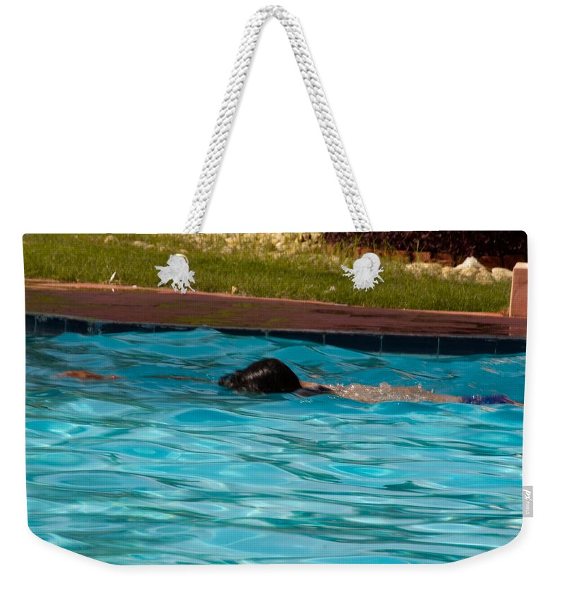 Swim Weekender Tote Bag featuring the photograph Enjoying A Swim by Ashish Agarwal