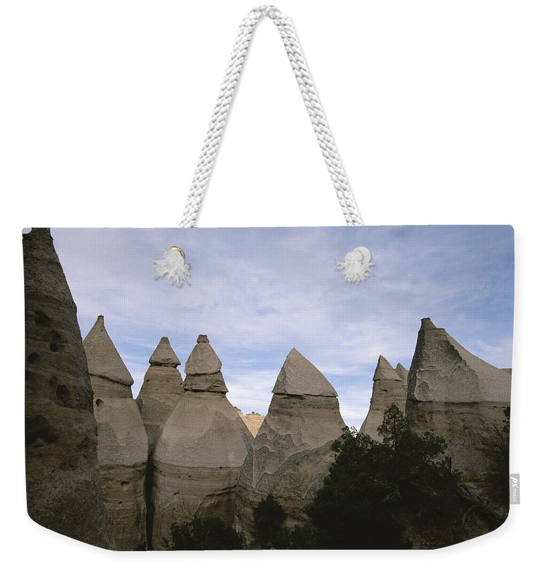New Mexico Weekender Tote Bag featuring the photograph Erosion-chiseled Rock Formations Formed by Melissa Farlow