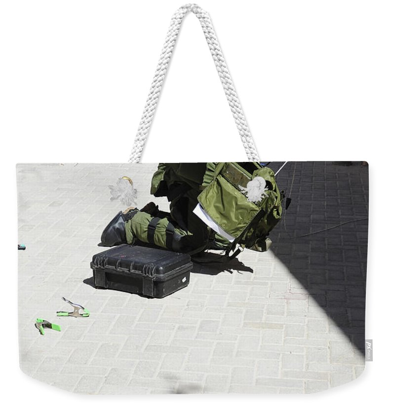 Military Weekender Tote Bag featuring the photograph Explosive Ordnance Disposal Technician by Stocktrek Images