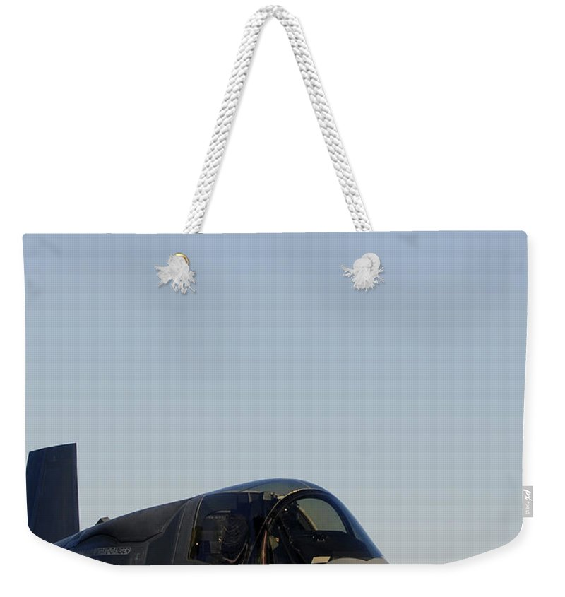 Aerospace Weekender Tote Bag featuring the photograph F-35b Lighnting II Variants Land Aboard by Stocktrek Images