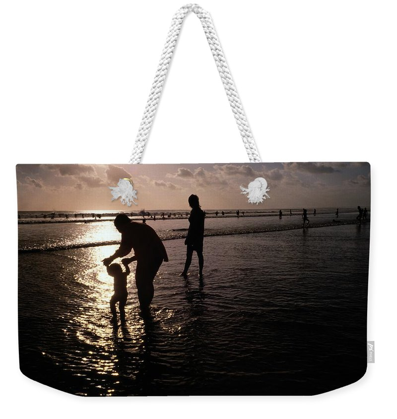Bali Weekender Tote Bag featuring the photograph Families Play In A Shallow Lagoon by Michael Nichols
