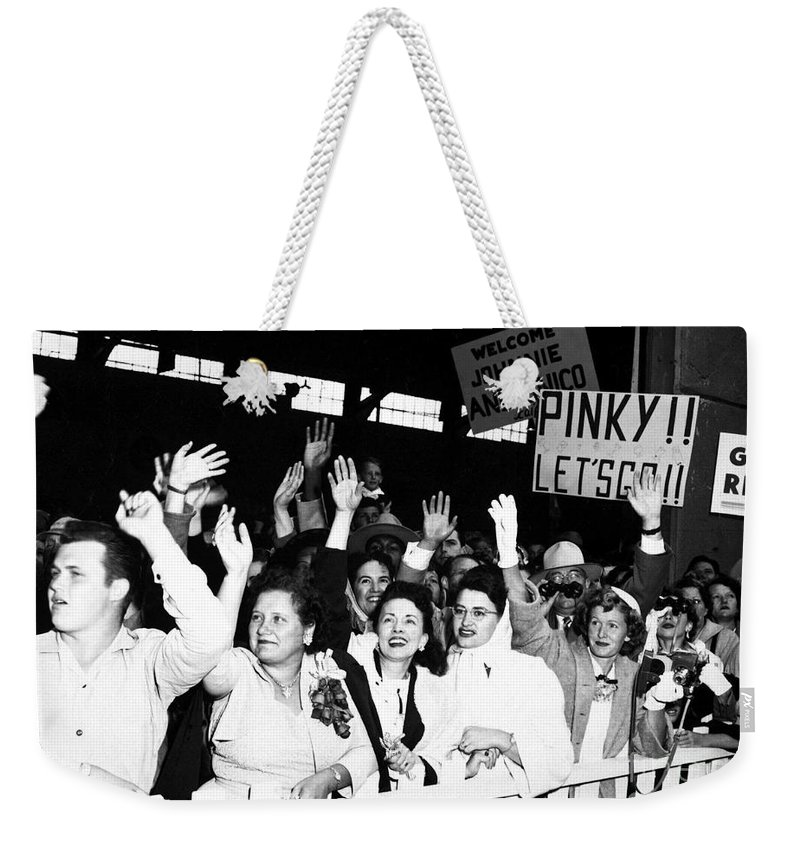 Horizontal Weekender Tote Bag featuring the photograph Families Waving And Greeting The Return by Stocktrek Images