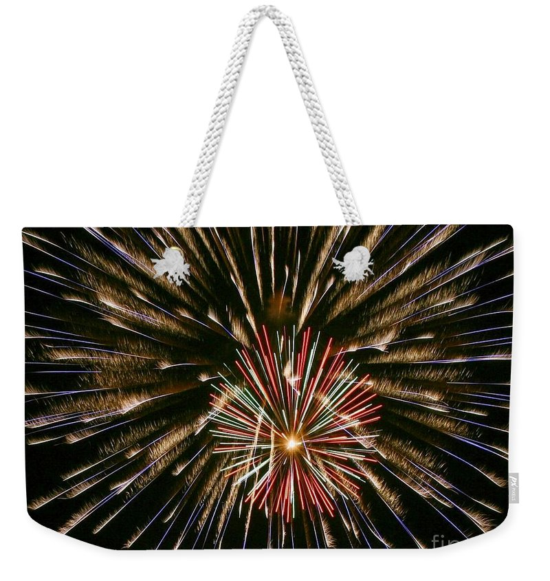 Fireworks Weekender Tote Bag featuring the photograph Feathers Of Fire by Myrna Bradshaw