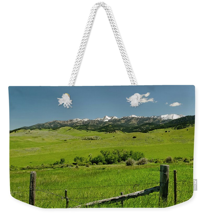 Americas Weekender Tote Bag featuring the photograph Fence Line by Roderick Bley
